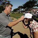 Actor, Kurt Russell autographs the hat of Joanne Gossett, of Atwater, Ca., while playing the Monterey Peninsula course during round 1 action of the AT&T Pebble Beach National Pro-Am in Pebble Beach, Ca. on Thursday Feb. 10, 2011.