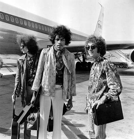 August 1967: The Jimi Hendrix Experience at London Airport, from left to right; bass player Noel Redding (1945 - 2003), legendary guitarist Jimi Hendrix and drummer Mitch Mitchell. Photo: George Stroud