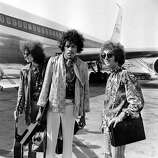 21st August 1967: The Jimi Hendrix Experience at London Airport, from left to right; bass player Noel Redding (1945 - 2003), legendary guitarist Jimi Hendrix and drummer Mitch Mitchell..