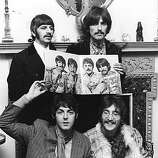 "22nd May 1967: The Beatles (clockwise from top left: Ringo Starr, George Harrison (1943 - 2001), John Lennon (1940 - 1980) and Paul McCartney) pose for a photocall to promote their new album ""Sergeant Pepper's Lonely Hearts Club Band.""."