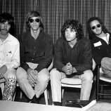 3rd September 1968: American psychedelic rock band, The Doors during a press conference at Heathrow Airport, London (left to right); drummer John Densmore, keyboard player Ray Mansarek, vocalist Jim Morrison (1943 - 1971) and guitarist Robby Krieger..