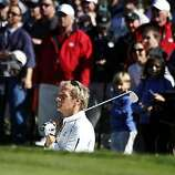 Michael Bolton waits his turn to hit out of the trap and onto the 3rd green rduring the Celebrity Challenge at Pebble Beach Golf links site of the annual AT&T National Pro-Am Golf Tournament Wednesday Feb. 9, 2010. Wednesday Feb 9, 2011