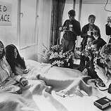 "25th March 1969: Beatles singer, songwriter and guitarist John Lennon and his wife of a week Yoko Ono receive the press at their bedside in the Presidential Suite of the Hilton Hotel, Amsterdam. The couple stayed in bed for seven days ""as a protest against war and violence in the world.""."
