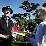Actor-Comedian Bill Murray puckers up after Caroline Talley from the Beach Club served him shrimp appetizers on the 17th fairway during the Celebrity Challenge at Pebble Beach Golf links site of the annual AT&T National Pro-Am Golf Tournament Wednesday Feb. 9, 2010. Wednesday Feb 9, 2011.