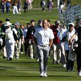 Kelly Slater leads the gallery up the 18th fairway during the Celebrity Challenge at Pebble Beach Golf links site of the annual AT&T National Pro-Am Golf Tournament Wednesday Feb. 9, 2010. Wednesday Feb 9, 2011