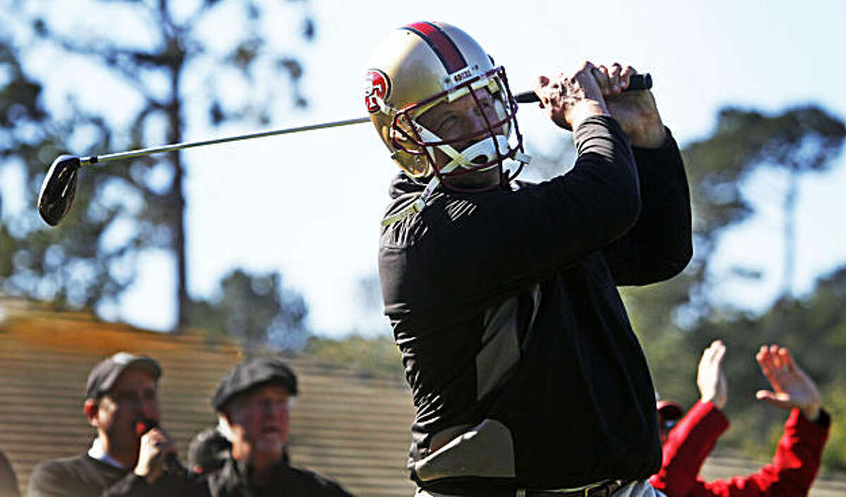 49ers great Harris Barton wears a helmet as he tees off at the first hole for the 49ers-Giants charity shootout at the AT&T Pro-Am in Pebble Beach on Tuesday.