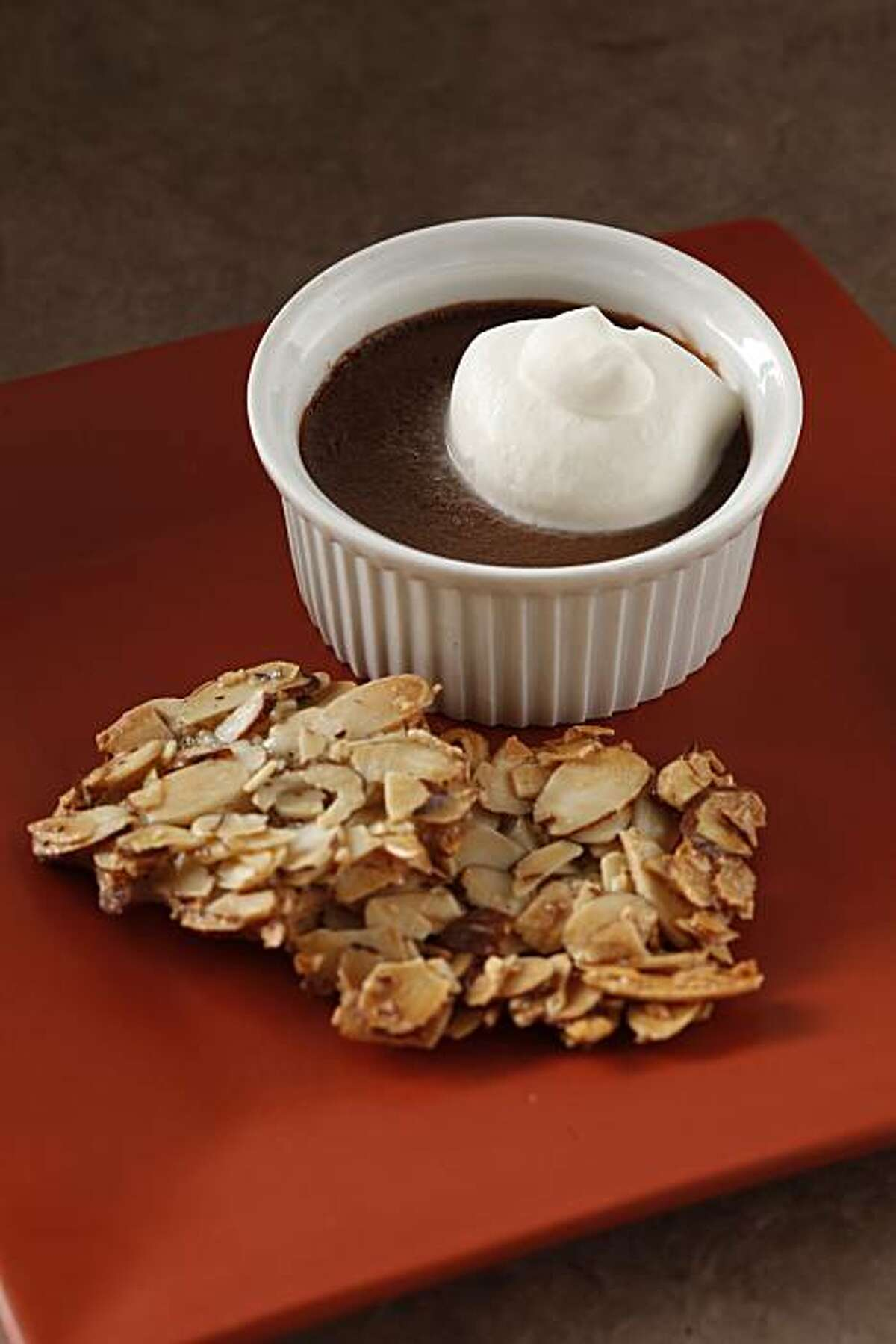 Chocolate pots de creme (Foreign Cinema) with Naomi's Almond Wafers as seen in San Francisco, California, on January 19, 2011. Food styled by Kelly Rae Hickman.