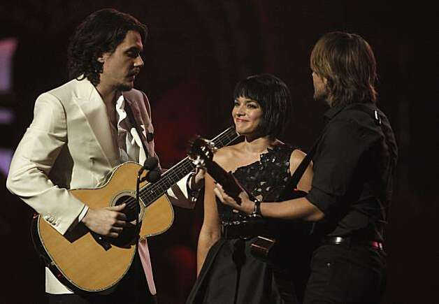 From left, John Mayer, Norah Jones and Keith Urban are seen onstage at the 53rd annual Grammy Awards on Sunday, Feb. 13, 2011, in Los Angeles. Photo: Matt Sayles, AP