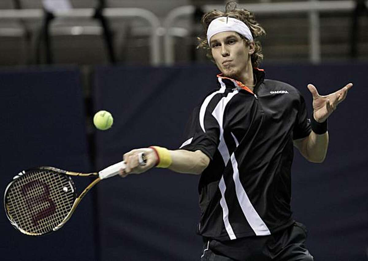 Lukas Lacko, of Slovakia, returns to Sam Querrey, of the United States, in the first round of the SAP Open tennis tournament in San Jose, Calif., Tuesday, Feb. 8, 2011.