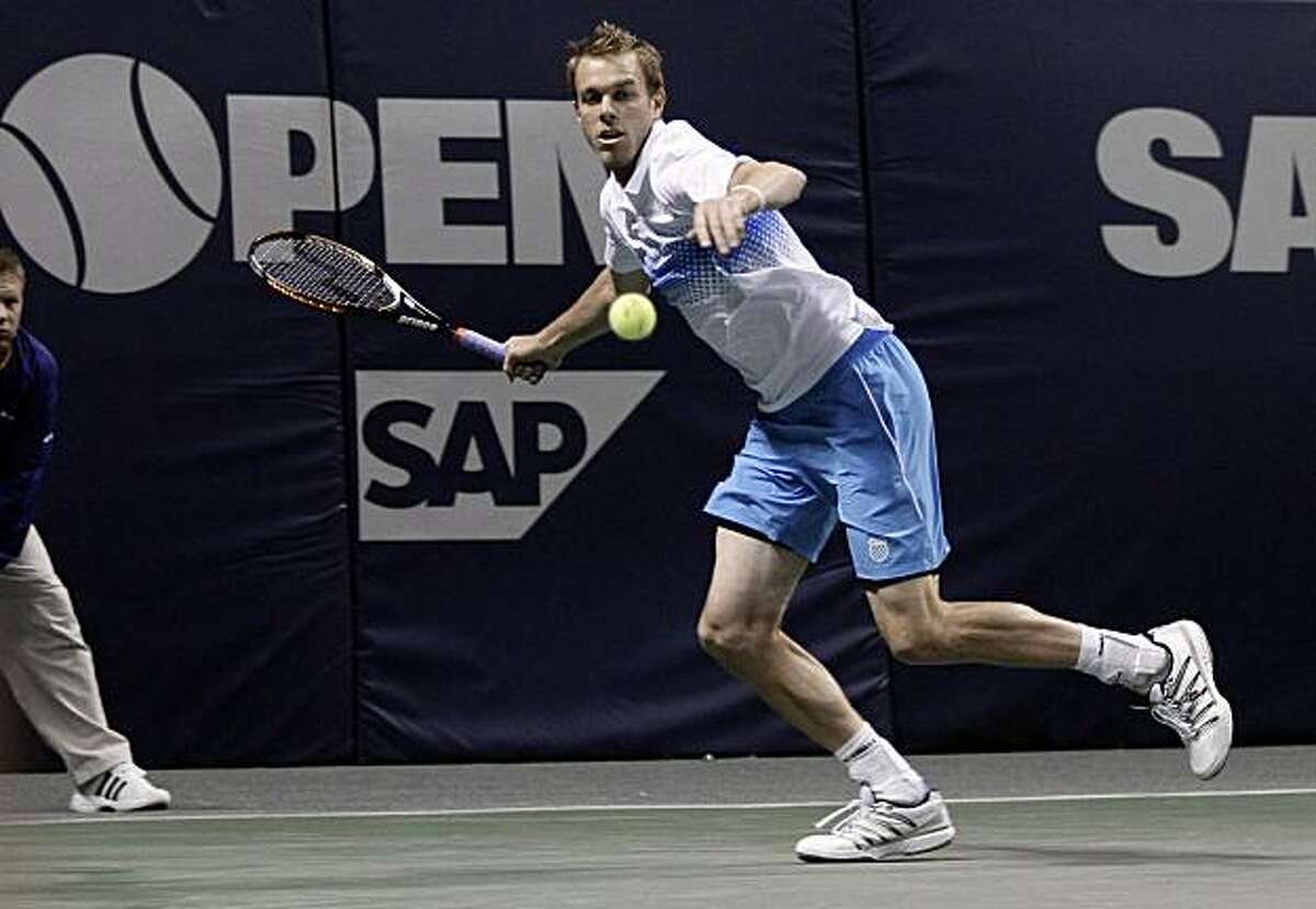 Sam Querrey, of the United States, prepares to hit a forehand to Lukas Lacko, of Slovakia, in the first round of the SAP Open tennis tournament in San Jose, Calif., Tuesday, Feb. 8, 2011.