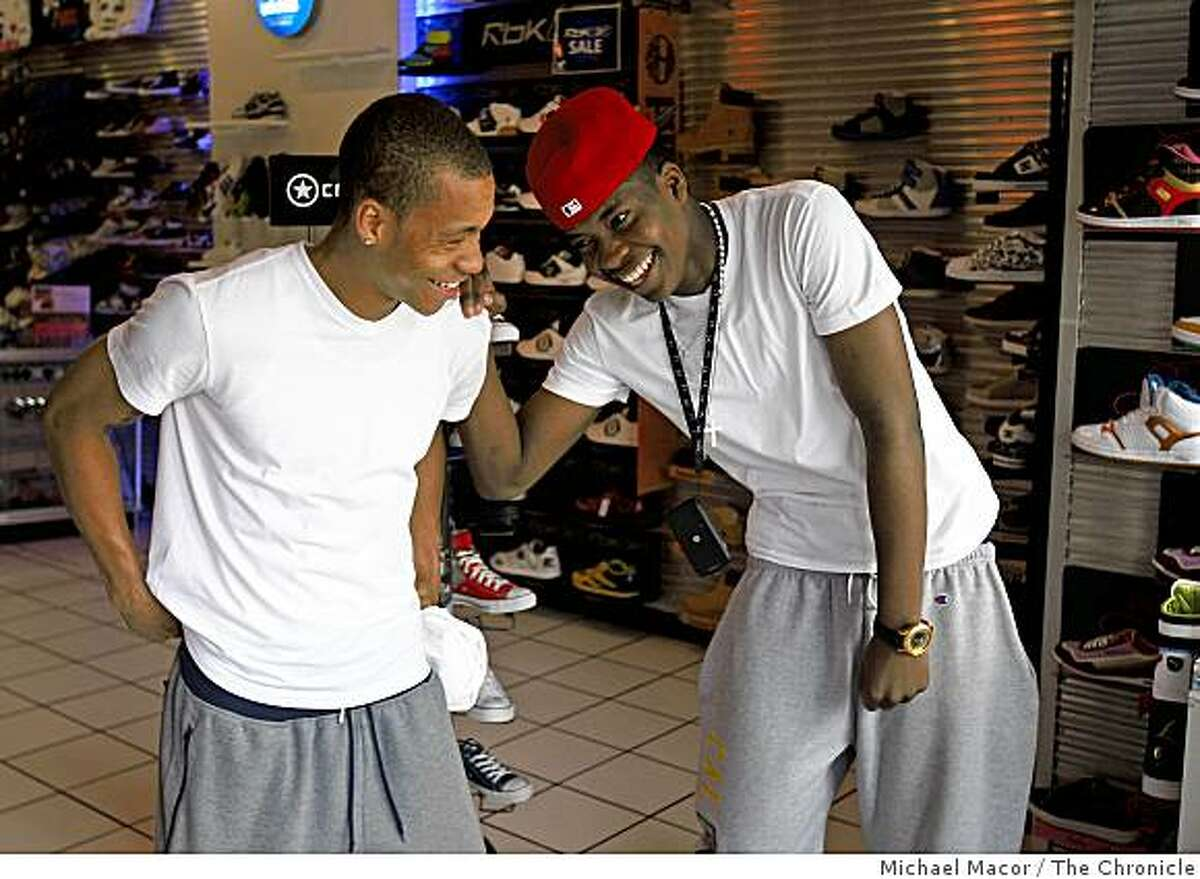 Jerome Randle, (left) and his brother Jeremy, the two share a laugh at the shoe store that Jeremy works at on Telegraph Ave, across the street from the UC campus in Berkeley, Calif. on Wednesday Feb. 18, 2009. Jerome, 21 years-old, is a player on the Cal Berkeley basketball team and his younger brother Jeremy is 18 years-old, the older moved his brother out to California to live with him.