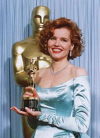 "Geena Davis shows off her Oscar March 30, 1989 after winning Best Supporting Actress at the 61st Academy Awards for her role in the ""Accidental Tourist."" (AP Photo/ Lennox McLendon) Photo: Lennox Mclendon"