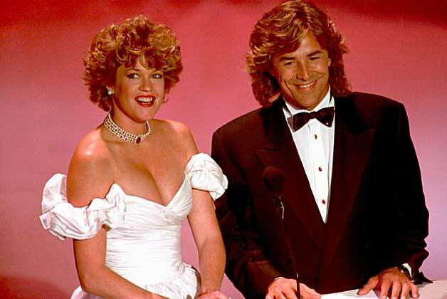 Oscar nominee Melanie Griffith, left, and actor Don Johnson are presenters at the 61st annual Academy Awards at the Shrine Civic Auditorium in Los Angeles, Ca., on March 29, 1989.  (AP Photo/Reed Saxon) Photo: Reed Saxon