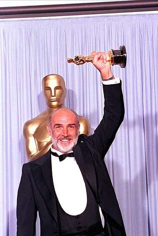 "Sean Connery holds his first Oscar statuette at the 60th annual Academy Awards in Los Angeles, Ca., April 11, 1988.  Connery won for best supporting actor for his role in ""The Untouchables.""  (AP Photo/Lennox McLendon) Photo: Lennox Mclendon"