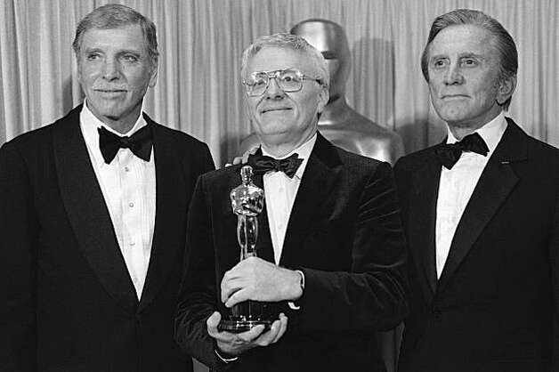 "Actor Burt Lancaster, left, and actor Kirk Douglas, right, stand with Peter Shaffer, winner of the best adapted screenplay Oscar ""Amadeus"", during the Academy Awards in Los Angeles, Ca., March 25, 1985. (AP Photo) Photo: Anonymous"