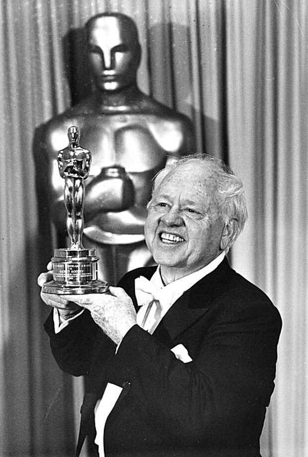 Actor Mickey Rooney poses with his Honorary Oscar for Lifetime Achievement at the 55th Annual Academy Awards ceremony in Los Angeles, Ca., April 10, 1983.  Rooney is honored for his 60 years of contribution to the motion picture industry.  (AP Photo)