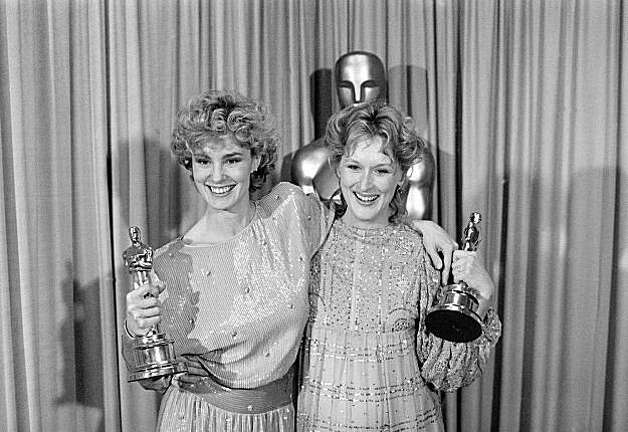 "Oscar winners Jessica Lange, left, and Meryl Streep pose backstage at the 55th annual Academy Awards in Los Angeles, Ca., Monday night, April 11, 1983.  Lange was named best supporting actress for her role in ""Tootsie.""  Streep won best actress for her role in ""Sophie's Choice.""  (AP Photo)"