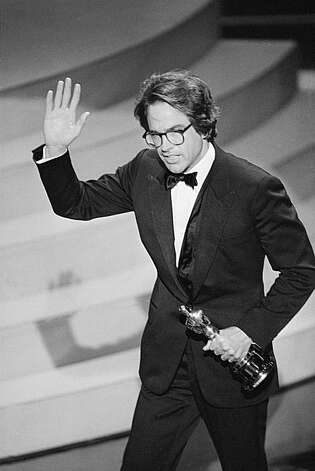 "Warren Beatty waves to the audience as he leaves the stage after accepting an Oscar for best achievement in directing by the Academy of Motion Picture Arts and Sciences,  March 29, 1982 in Los Angeles during the Academy Award.  Beatty was honored for his direction of the movie ""Reds."" (AP Photo) Photo: Anonymous"