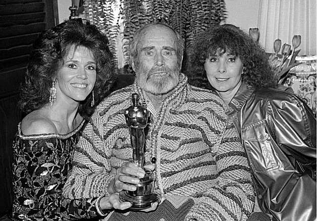 "Actor Henry Fonda poses with the Oscar he won for his performance in ""On Golden Pond"" at his home in Bel Air, Ca., late Monday night, March 29, 1982.  At left is his daughter, actress Jane, and at right is his wife, Shirlee.  Fonda is too ill to have attended the Academy Awards ceremony.  (AP Photo/Wally Fong) Photo: Wally Fong"