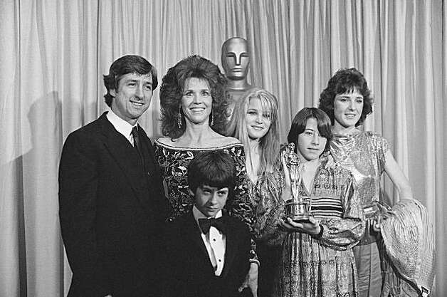 "Jane Fonda stands with her husband, Tom Hayden, at left,  and members of her family to accept an Oscar on behalf of her father, Henry Fonda at the Academy Awards in Los Angeles, March 29,1982.   Henry Fonda, who is ailing, was honored for best performance by a leading actor for his role in ""On Golden Pond.""    Shown from left: Tom Hayden, wife Jane Fonda, Bridget Fonda, Amy Fonda, and Vanessa Vadim.   Troy Garity Hayden, stands in front of his mother.   Vanessa Vadim, is the daughter of Jane; Bridget is a niece of Jane; and Amy, holding the Oscar, is the adopted daughter of Henry Fonda.   Henry Fonda was not present at the awards   (AP Photo) Photo: Anonymous"