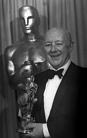 Sir Alec Guinness is shown being honored with a Special Oscar in this 1980 photo during the 52nd Annual Academy Awards in Los Angeles.  (AP Photo)