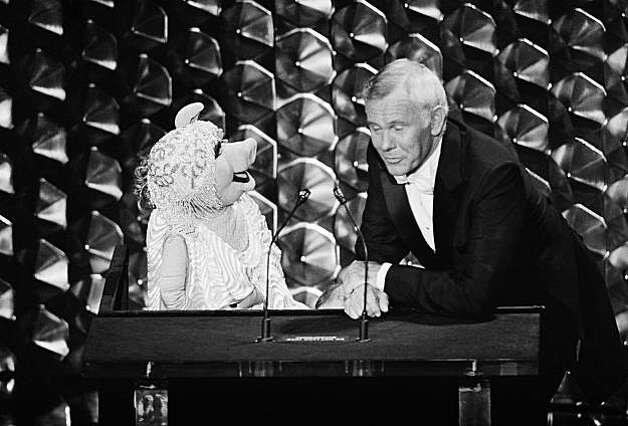 Host of the Academy Awards, Johnny Carson, gets the word from Muppet character Miss Piggy as she voices her dissatisfaction at not being nominated during the 52nd Oscar Presentation in Los Angeles Monday, April 14, 1980. (AP Photo) Photo: Anonymous
