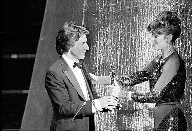 "Actress Jane Fonda presents the Oscar for best actor in a leading role to Dustin Hoffman for his performance in the motion picture ""Kramer vs. Kramer,"" at the 52nd annual Academy Awards show in Los Angeles, Calif., on April 14, 1980. (AP Photo)"