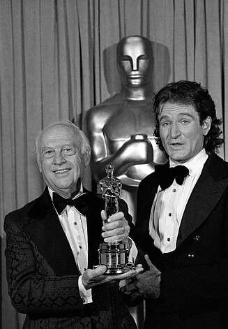 "Producer and director of animation in short subjects Walter Lantz (left) receives an honorary Oscar from television's newest star Robin Williams of the ""Mork and Minday"" series. Award was made at the 51st Academy of Motion Picture Arts and Sciences show in Los Angeles Monday, April 10, 1979. (AP Photo). Photo: Anonymous"