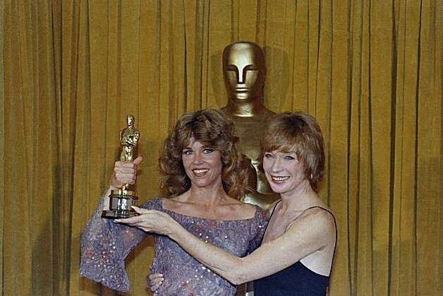 "Jane Fonda, Oscar Winner for Best Actress in ""Coming Home"" with presenters Shirley Maclaine, April 9, 1979 a the 51st  Academy Awards in Los Angeles.  (AP Photo) Photo: Anonymous"