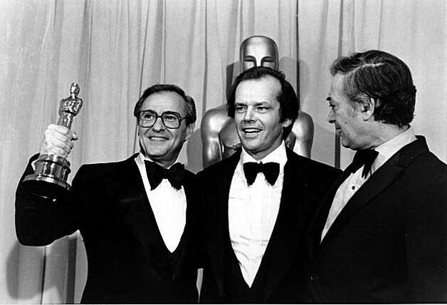 "Producer Charles Joffe, holding the Oscar, actor Jack Nicholson, center, and Joffe's co-producer Jack Rollins are shown at the 50th Annual Academy Awards at the Los Angeles Music Center, Calif., on April 4, 1978. ""Annie Hall"" won best picture of the year, which was co-produced by Joffe and Rollins. (AP Photo)"