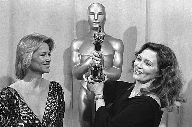 Actress Faye Dunaway wins the best actress award at the Academy awards in Los Angeles, March 28, 1977. With her is the presenter of the Oscar, actress Louise Fletcher, a previous winner. (AP Photo) Photo: Anonymous
