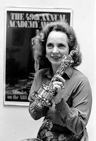 "Actress Beatrice Straight displays her Oscar statuette during an interview in Los Angeles, Calif., on April 14, 1977.  Straight won the award for best supporting actress for 1976 for her role in ""Network.""  (AP Photo)"
