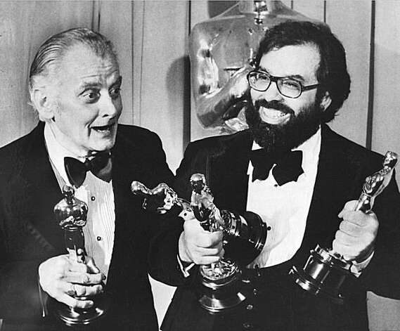 "Art Carney, left, and Francis Ford Coppola pose with their Oscar statuettes at the Academy Awards presentation in Los Angeles, Ca., April 8, 1975.  Carney was named best actor of the year for his role in ""Harry and Tonto.""  Coppola won Oscars for ""The Godfather Part II"" in three categories, best direction, best screenplay adaptation and best movie of the year.  (AP Photo)"