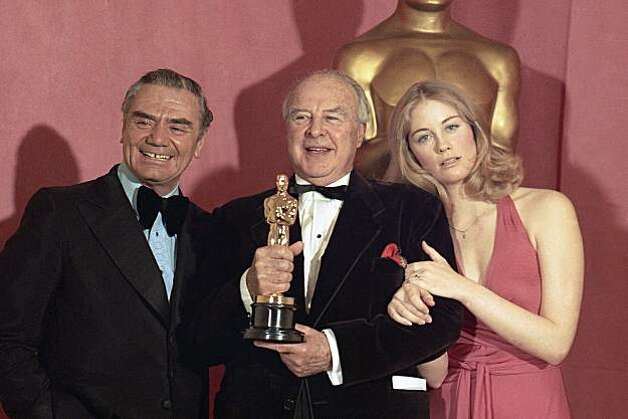"Actor-director John Houseman holds his Oscar as he poses with actor Ernest Borgnine and actress Cybill Shepherd, right, at the Academy Awards in Los Angeles, Ca., Tuesday night, April 2, 1974. Houseman won best supporting actor for his role in ""The Paper Chase."" (AP Photo)"