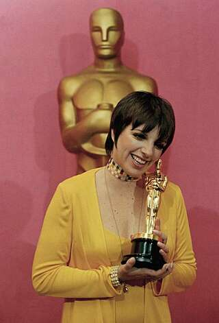 "Liza Minnelli holds her Oscar for ""Actress in a Leading Role,"" for her work in film, ""Cabaret,  at the 45th Academy Awards show on March 27, 1973 at  Los Angeles, Calif.  (AP Photo) Photo: Anonymous"