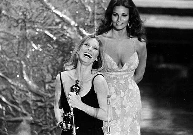 "Actress Cloris Leachman accepts her Oscar at the 44th annual Academy Awards ceremony at the Music Center in Los Angeles, Ca., on April 10, 1972.  Leachman won for best supporting actress for her role in ""The Last Picture Show.""   In the background is presenter and actress Raquel Welch.  (AP Photo)"