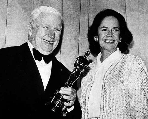 Actor Charlie Chaplin displays the honorary Oscar he received, April 10, 1972, at the 44th Annual Academy Awards at the Music Center in Los Angeles,  with his wife Oona at his side.  (AP Photo) Photo: Anonymous