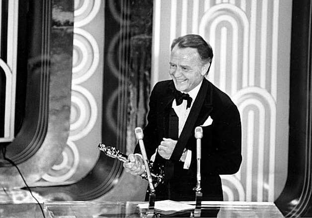 "British actor John Mills holds the Oscar he received at the Academy Awards ceremony at the Music Center in Los Angeles, Ca., April 15, 1971.  Mills won best supporting actor for his role in the movie ""Ryan's Daughter.""  Mills' arm is in a sling from an accident in London when his finger was smashed in a car door.  (AP Photo)"
