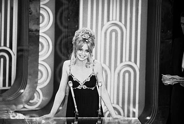 "Actress Goldie Hawn announces that George C. Scott had won the Academy Award for best actor for his role in ""Patton,"" at ceremonies at the Los Angeles Music Center in Hollywood, Los Angeles on April 15, 1971. Scott, who scorned the Academy Awards as contrived and degrading, said he would send the Oscar back if it was sent to him. The Academy said the statuette will be held for him if he wants it. (AP Photo) Photo: Anonymous"