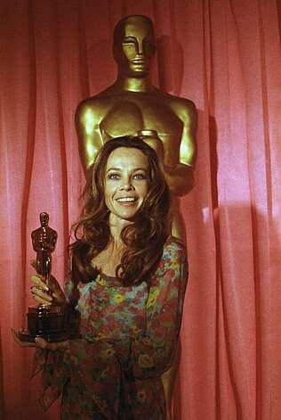 "Actress Leslie Caron olds the Oscar that she accepted for the best Italian foreign film ""Investigation of a Citizen above Suspicion"" a t the 43rd Academy Awards in Hollywood, April 15, 1971. (AP Photo) Photo: Anonymous"