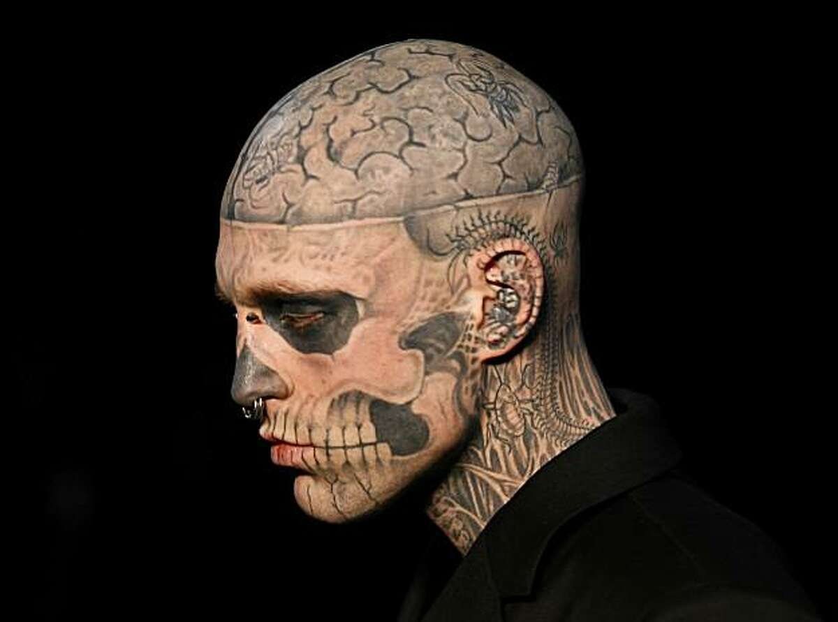 A tattooed model presents a creation by French designer Thierry Mugler during the Men's fall-winter 2011-2012 ready-to-wear collection show on January 19, 2011 in Paris.
