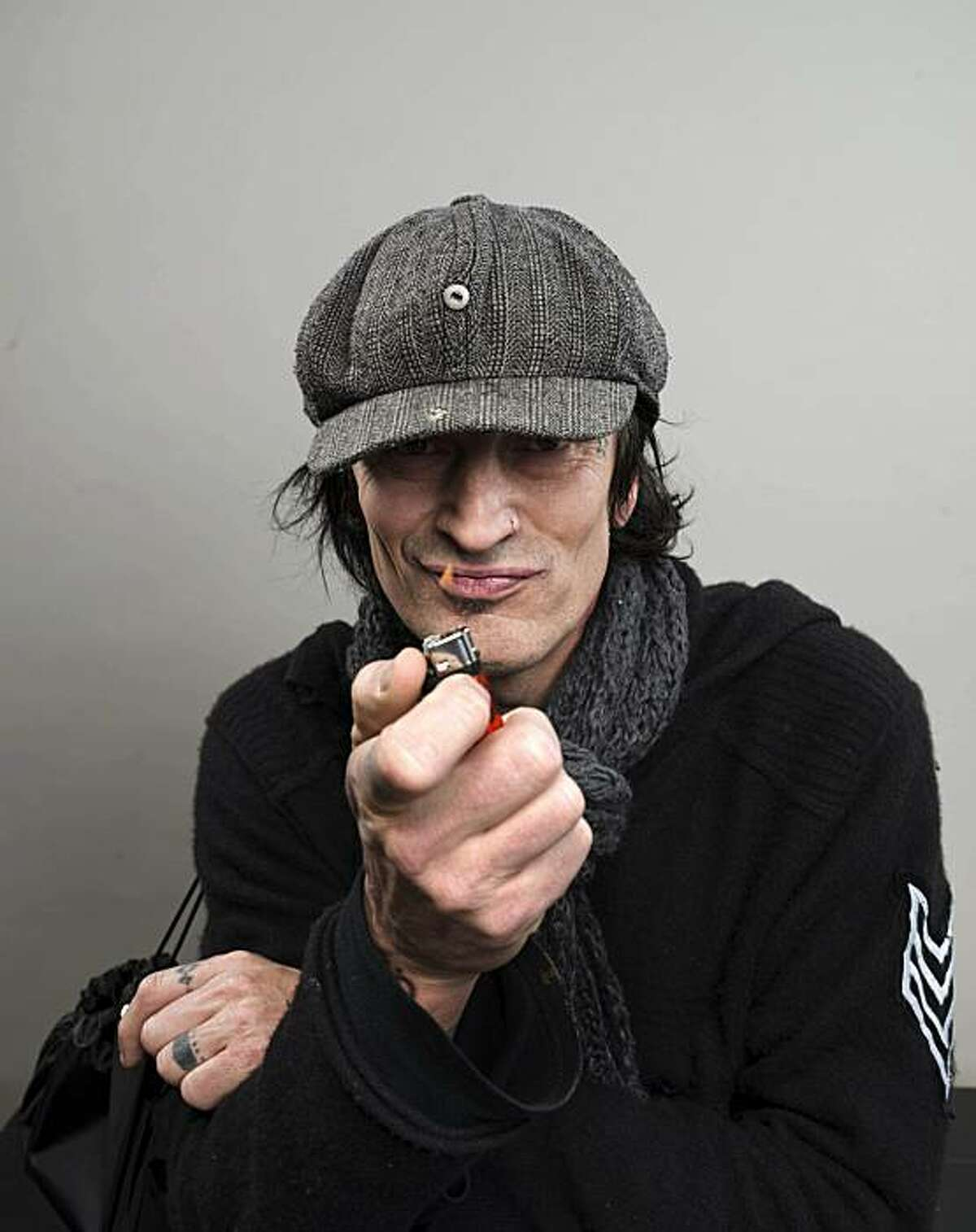 Motley Crue rocker Tommy Lee turns 50 today, Wednesday, October 3, 2012. Here he poses for a portrait last year.