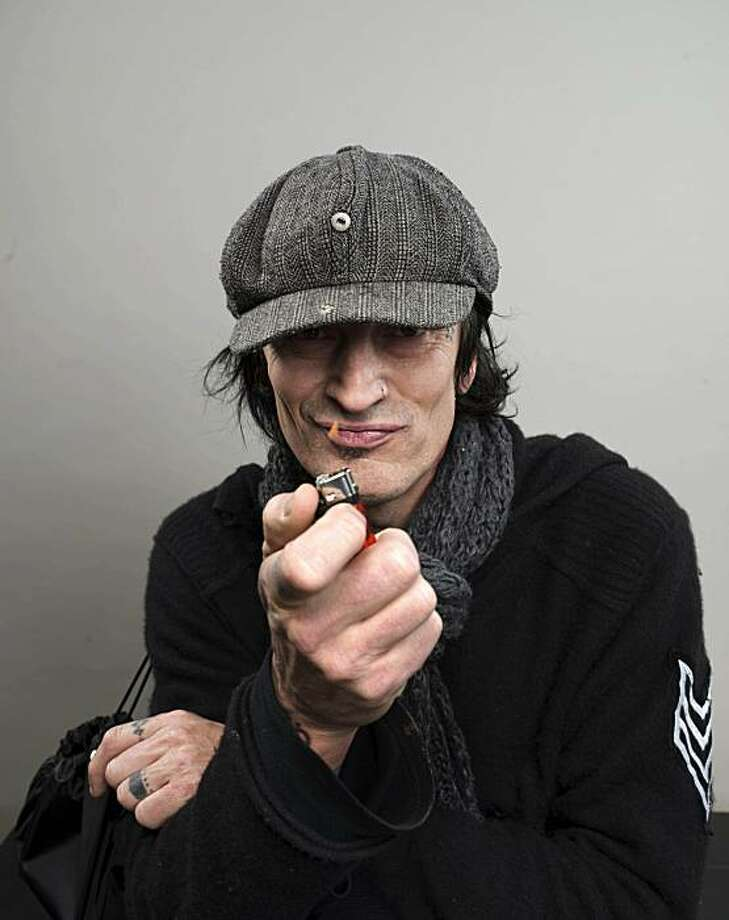 Motley Crue rocker Tommy Lee turns 50 today, Wednesday, October 3, 2012. Here he poses for a portrait last year. Photo: Victoria Will, AP