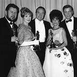 "Master of Ceremonies Bob Hope, center, poses with four Oscar winners after the Academy Awards ceremony in Santa Monica, Calif. on April 18, 1961.  Photographed with Hope are, from left to right,  British actor Peter Ustinov,  best supporting actor for his role in ""Spartacus""; Shirley Jones, best supporting actress for her role in ""Elmer Gantry""; Elizabeth Taylor, best actress for her role in ""Butterfield 8""; and Burt Lancaster, best actor for his role in ""Elmer Gantry."" (AP Photo/stf)"