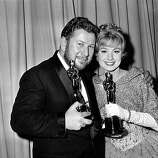 "Oscar winners Peter Ustinov, left, and actress Shirley Jones pose at the Academy Awards at the Santa Monica Civic Auditorium, Ca., on April 17, 1961.  Ustinov won best supporting actor for ""Spartacus,"" and Jones won best supporting actress for ""Elmer Gantry.""   (AP Photo)"