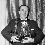 At the Academy Awards in Hollywood, Calif., March 25, 1954, Walt Disney received four Oscars for: The Living Desert (Best Feature-length Documentary of 1953), Bear Country (Best Two-reel Subject of 1953), The Alaskan Eskimo (Best Short Subject Documentary for 1953), Toot, Whistle, Plunk and Boom (Best Cartoon of 1953). (AP Photo)