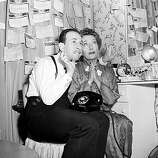 "Oscar nominees Jose Ferrer and Gloria Swanson cross their fingers as they wait for news from Hollywood, where the Academy Awards are held, backstage at the Fulton Theater in New York City on March 29, 1951.  Swanson is nominated for best actress for her role in ""Sunset Boulevard.""  Ferrer is nominated for best actor for his role in ""Cyrano de Bergerac,"" and won the award.  Swanson and Ferrer are starring in the Broadway play ""Twentieth Century,"" directed by Ferrer.  (AP Photo)"