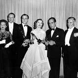 "Oscar winners and presenters pose backstage at the 1951 Academy Awards held at the RKO Pantages Theatre in Hollywood, Ca., March 20, 1952.  From left to right are, Bette Davis, who accepted Kim Hunter's Oscar for best supporting actress in ""A Streetcar Named Desire""; George Sanders, presenter; Karl Malden, named best supporting actor in ""A Streetcar Named Desire""; Greer Garson, who accepted Vivien Leigh's best actresss award for ""A Streetcar Named Desire""; Humphrey Bogart, best actor for ""The African Queen""; and presenter Ronald Colman.  (AP Photo)"