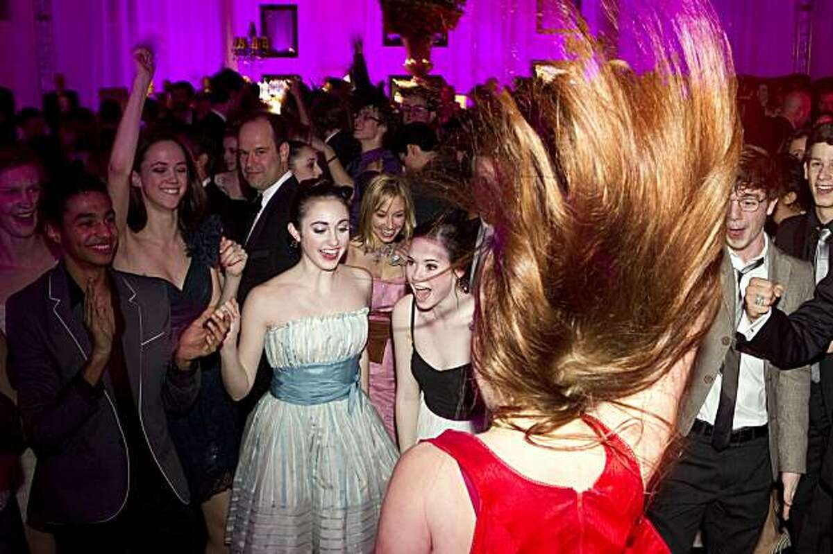 Elizabeth Castaneda (front center) goes wild on the dance floor as students from the San Francisco Ballet School and company members cheer her on during the post party for the San Francisco Ballet 2011 Opening Night Gala at City Hall in San Francisco, Calif., on Wednesday, January 26, 2011.