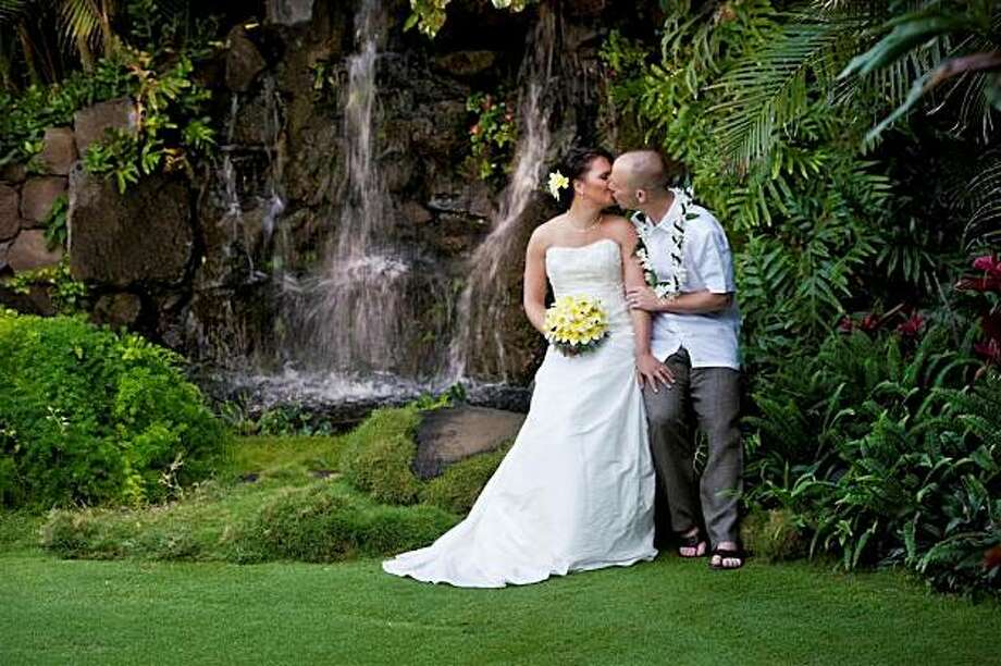 The private Pukalani Falls Garden on O'ahu provides a waterfall backdrop for uniquely customized weddings by its owner, Capt. Howie. Photo: Pukalani Falls Hawaii Weddings